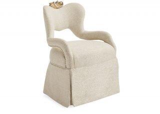 baroque skirted armchair